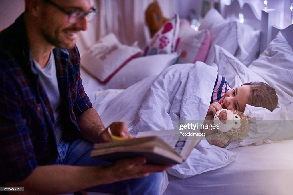 Just one more story daddy : Stock Photo