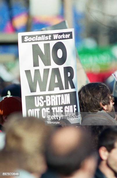 Just one placard in a sea of placards during the Stop the War demonstration as it passes Green Park London 21st January 1991