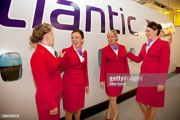Just one week away from getting their 'wings' these flight attendants proudly wear their red uniforms. Virgin Atlantic air stewardess and steward...