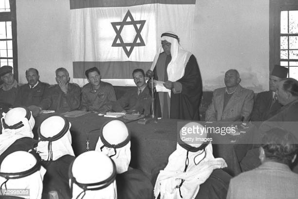 Just over a month after Israel's first occupation of this wartorn area Israeli military governors and Arab notables hold a ceremony commemorating the...