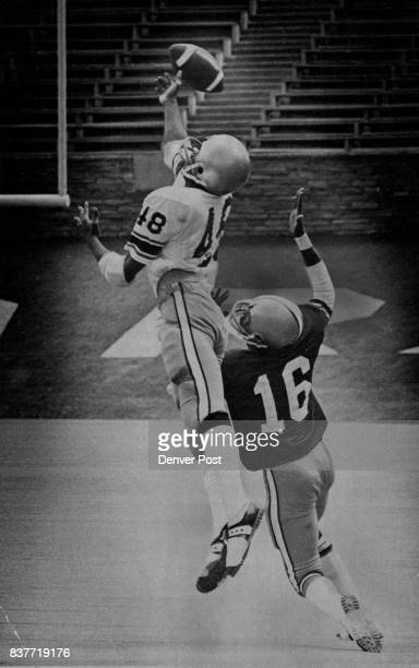 Just over the finger tips Receiver Larry Williams of the Silver team can't quite reach a pass as Tom Hilton of the Gold defends during Colorado's...