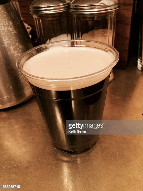 A just pulled Nitro Cold Brew coffee drink on a coffee counter inside the Ace Hotel in South Central Midtown Manhattan NYC February 6 2015