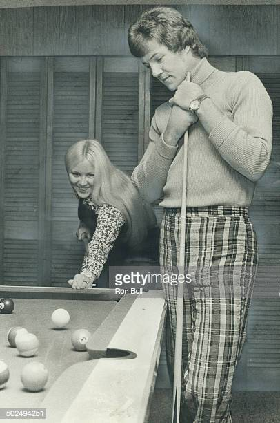 Just Relaxing Darrl Sittler forgets about hockey for a few moments and concentrates on how to beat his wife Wendy at the pool table But the...