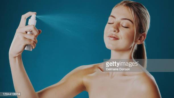 just spritz on to keep your makeup looking perfect - spraying stock pictures, royalty-free photos & images