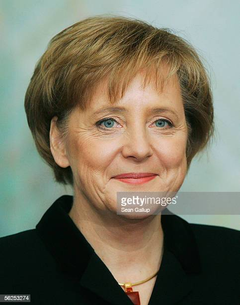 Just-appointed new German Chancellor Angela Merkel smiles after receiving her official document confirming her chancellorship from German President...