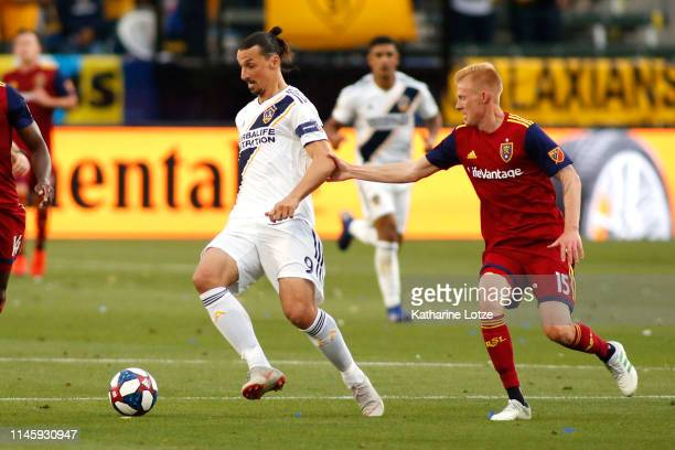 Justen Glad of Real Salt Lake grabs Zlatan Ibrahimovic of Los Angeles Galaxy during a game at Dignity Health Sports Park on April 28 2019 in Carson...