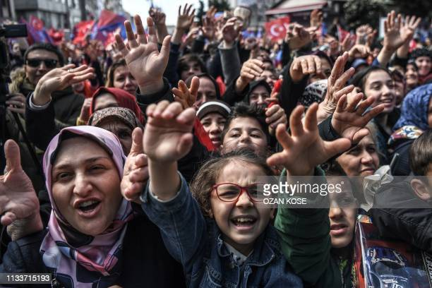 Justice and development party supporters cheer as Turkish President throws a bag of black tea to them during a preelection rally at Bayrampasa...
