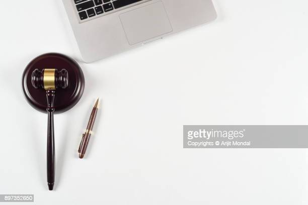 justice and law concept at lawyer workplace with laptop, gavel and sound block white background - legal trial stock pictures, royalty-free photos & images