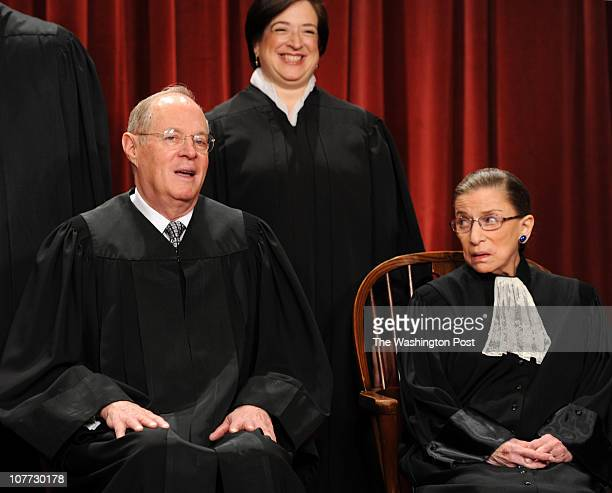 Justice Anthony Kennedy left chats with Justice Ruth Ginsburg right as the nine members of the Supreme Court pose for a new group photograph to...