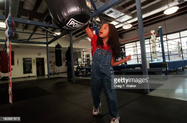 Justice Carr plays at the punching bag while wating for her mother boxer Freeda Foreman daughter of former heaveyweight champion George Foreman to...