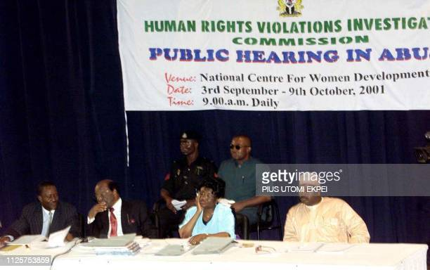Justice Chukwudifu Oputa chairman of the commission investigating three decades of human rights abuses in Nigeria discusses with fellow member of the...