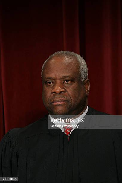 Justice Clarence Thomas poses for photographers at the US Supreme Court October 31 2005 in Washington DC Earlier in the day US President George W...