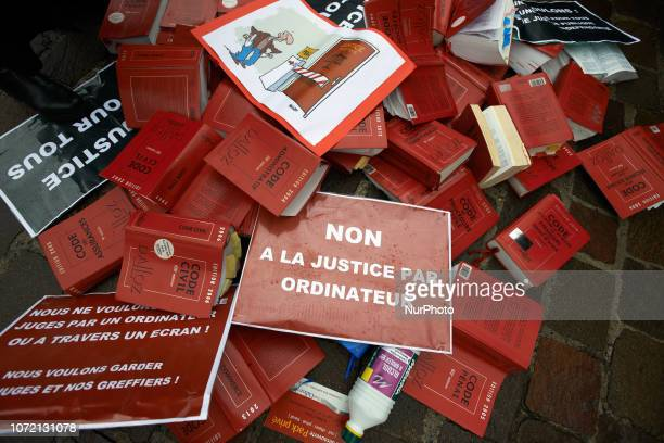 Justice codes throwed on the ground by lawyers and magistrates Lawyers counsels and magistrates gathered in front of the Toulouse' courthouse for a...