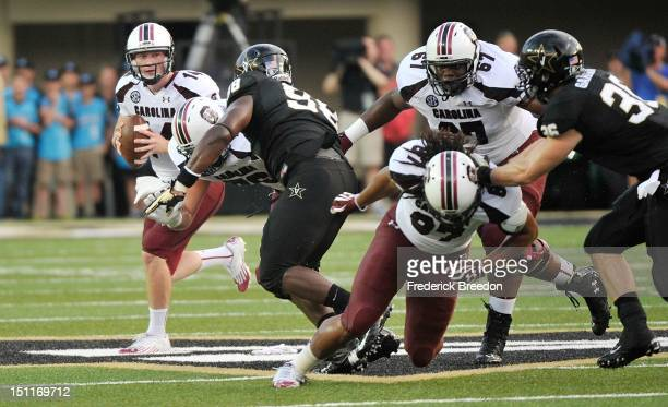 Justice Cunningham and Ronald Patrick of the South Carolina Gamecocks block for quarterback Connor Shaw against the Vanderbilt Commodores at...