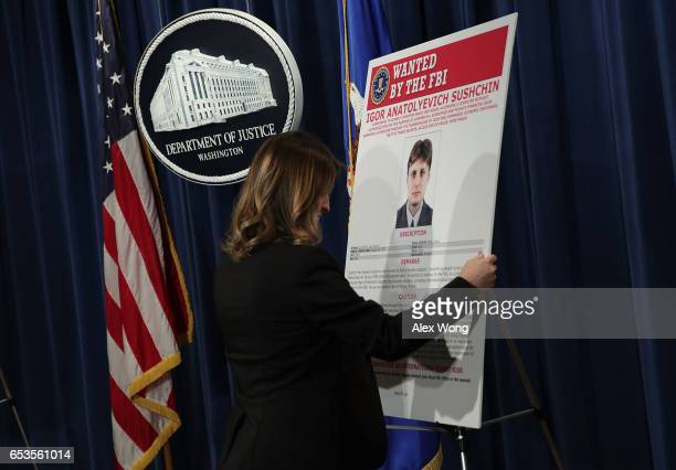 S Justice Department employee put up a wanted poster of Igor Anatolyevich Sushchin A Russian national and resident prior to a news conference at the...