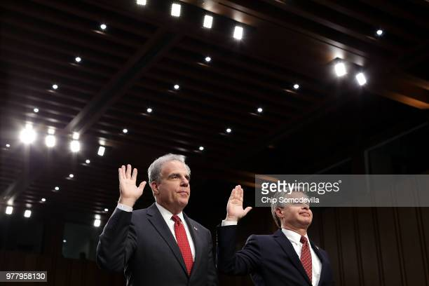 Justice Department Inspector General Michael Horowitz and Federal Bureau of Investigation Director Christopher Wray are sworn in before testifying to...