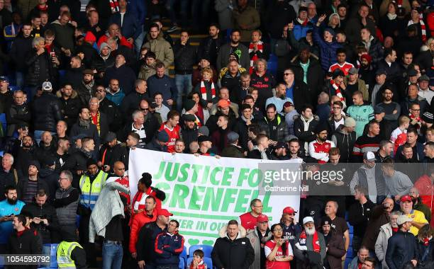 A 'Justice for Grenfell' banner is displayed by Arsenal supporters prior to the Premier League match between Crystal Palace and Arsenal FC at...