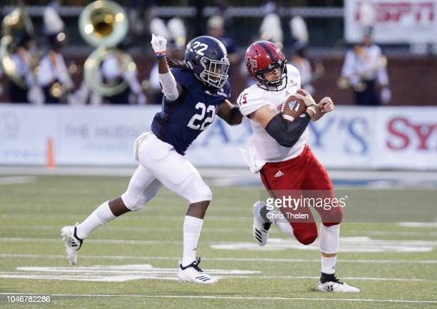 Justice Hansen of the Arkansas State Red Wolves is chased down by Joshua Moon of the Georgia Southern Eagles during the second quarter on September...