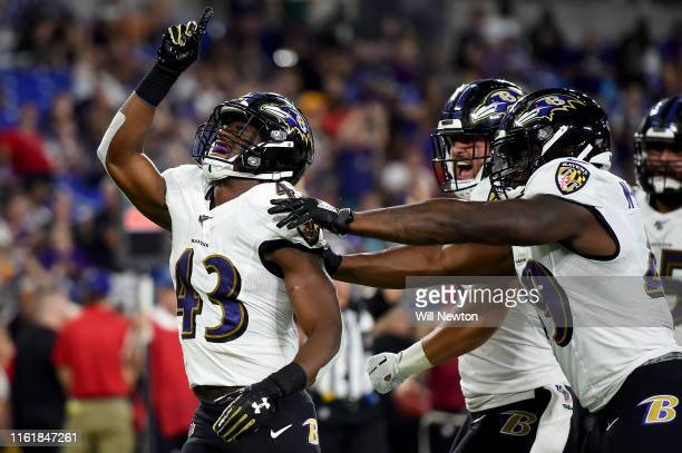 Justice Hill of the Baltimore Ravens celebrates with teammates after scoring a touchdown against the Green Bay Packers during the second half of a...