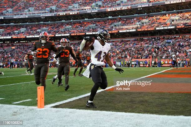 Justice Hill of the Baltimore Ravens scores a touchdown during the fourth quarter of the game against the Cleveland Browns at FirstEnergy Stadium on...