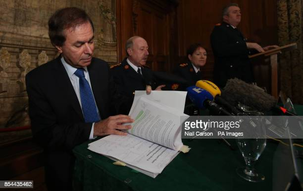 Justice Minister Alan Shatter reads a highlighted paragraph about Sinn Fein president Gerry Adams from his copy of the Smithwick report during a...