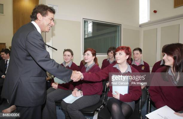 Justice Minister Alan Shatter shakes hands with students from Davis College in Mallow Co Cork at the launch of the The Child Rescue Ireland Alert...