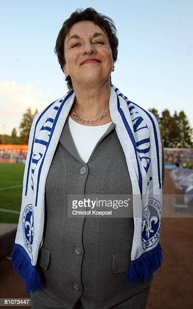 Justice Minister Brigitte Zypries poses with a scarf of football club Darmstadt 98 prior to the friendly match between Darmstadt 98 and Bayern Munich...