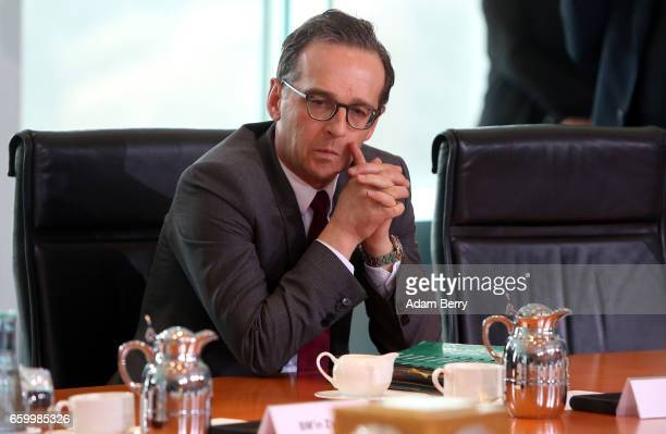 Justice Minister Heiko Maas arrives for the weekly German federal Cabinet meeting on March 29 2017 in Berlin Germany High on the meeting's agenda was...