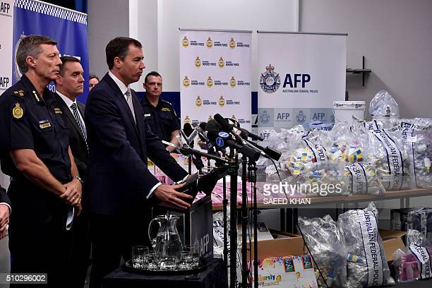 Justice Minister Michael Keenan speaks at a press conference during a presentation of seized crystal methamphetamine concealed in packaging at the...