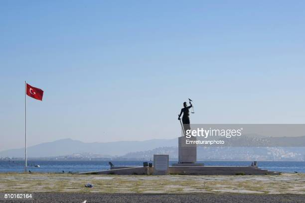 justice monument and turkish flag on inciralti district of izmir. - emreturanphoto stock pictures, royalty-free photos & images