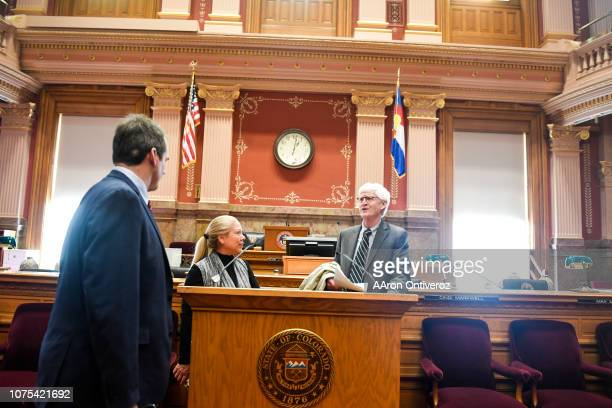 Justice Nathan B. Coats , the new Chief Justice of the Colorado Supreme Court, speaks with secretary of the Senate Cinid Marwell and Terry Scanlon at...