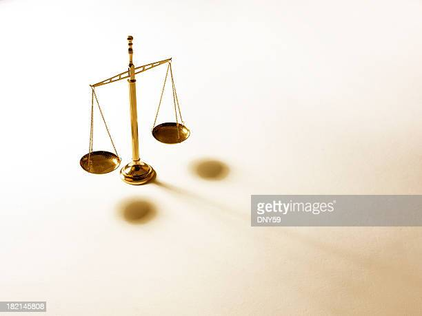 justice scale on warm tone background - equal arm balance stock pictures, royalty-free photos & images