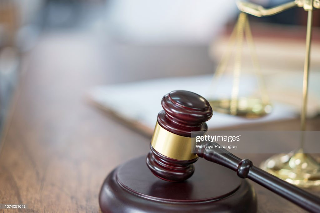 Justice Scales and books and wooden gavel : Stock Photo