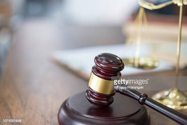 justice scales and books and wooden gavel - justice photos et images de collection