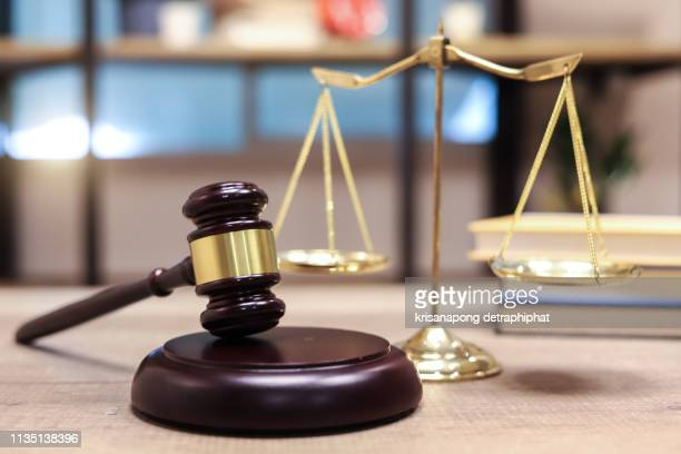 justice scales and books and wooden gavel - 正義 ストックフォトと画像