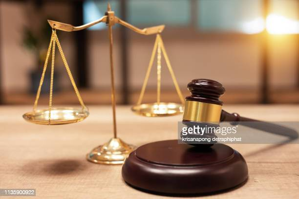 justice scales and books and wooden gavel - 裁判所 ストックフォトと画像