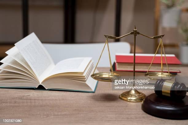 justice scales and wooden gavel. justice concept - rechtszaak stockfoto's en -beelden