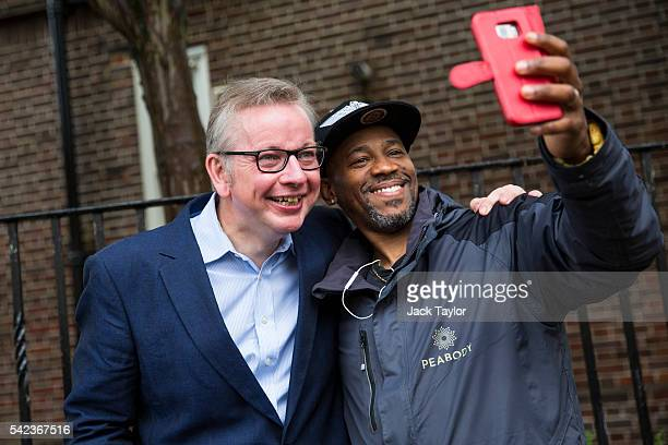 Justice Secretary and prominent 'Vote Leave' campaigner Michael Gove poses for a selfie with a member of the public after voting in the European...