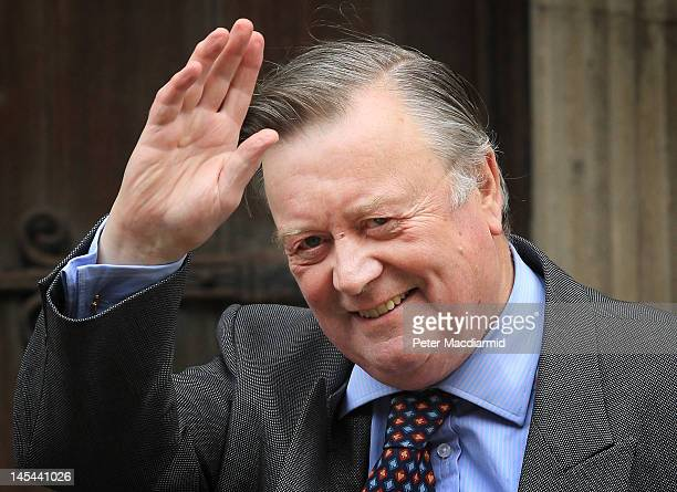 Justice Secretary Ken Clarke waves to photographers as he arrives at The Royal Courts of Justice give evidence to The Leveson Inquiry on May 30, 2012...