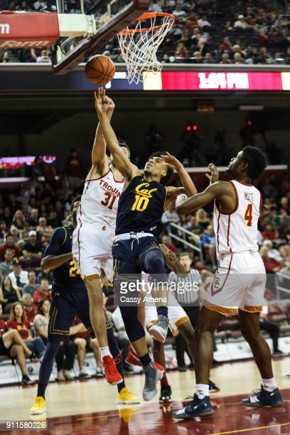 Justice Sueing of the California Golden Bears goes up for a layup against Nick Rakocevic and Chimezie Metu of the USC Trojans during a NCAA PAC12...