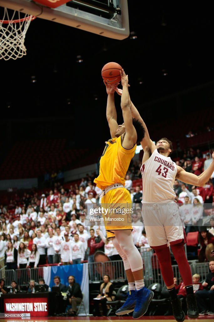 Justice Sueing #10 of the California Golden Bears goes up to rebound against Drick Bernstine #43 of the Washington State Cougars in the first half at Beasley Coliseum on January 13, 2018 in Pullman, Washington.