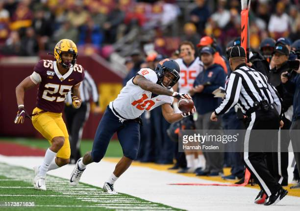 Justice Williams of the Illinois Fighting Illini catches the ball against Benjamin St-Juste of the Minnesota Gophers during the fourth quarter of the...