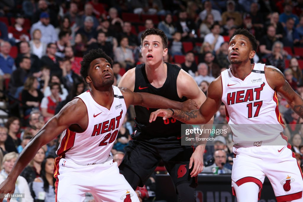 Justice Winslow #20 and Rodney McGruder #17 of the Miami Heat box out against Zach Collins #33 of the Portland Trail Blazers on March 12, 2018 at the Moda Center in Portland, Oregon.