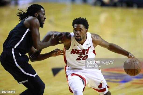 Justice Winslow of Miami Heat handles the ball against Demarre Carroll of Brooklyn Nets during the NBA game between the Brooklyn Nets and Miami Heat...