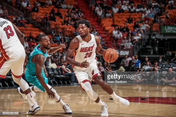 Justice Winslow of the Miami Heat handles the ball during the preseason game against the Charlotte Hornets on October 9 2017 at AmericanAirlines...