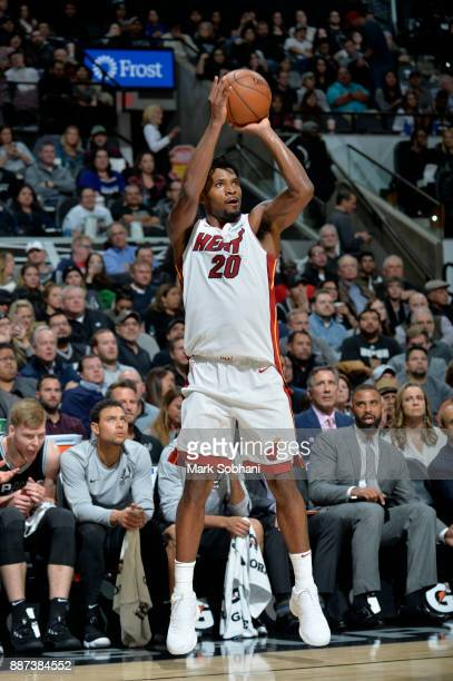 Justice Winslow of the Miami Heat shoots the ball against the San Antonio Spurs on December 6 2017 at the ATT Center in San Antonio Texas NOTE TO...