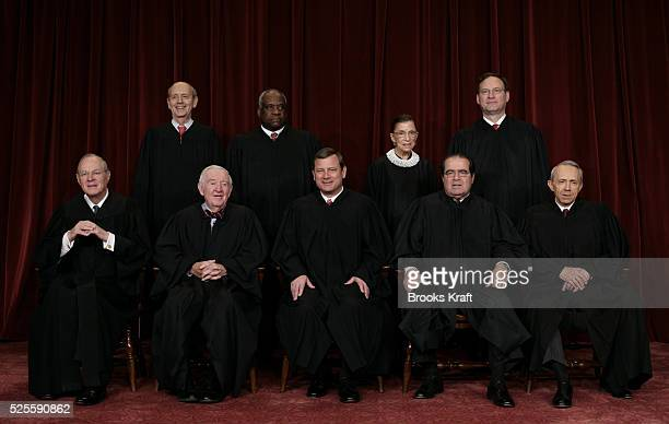Justices of the Supreme Court of the United States pose for a 2006 class photo inside the Supreme Court in Washington March 3 2006 Standing are...