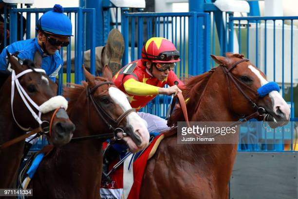 Justify ridden by jockey Mike Smith and Free Drop Billy ridden by jockey Robby Albarado breaks from the gate during the 150th running of the Belmont...