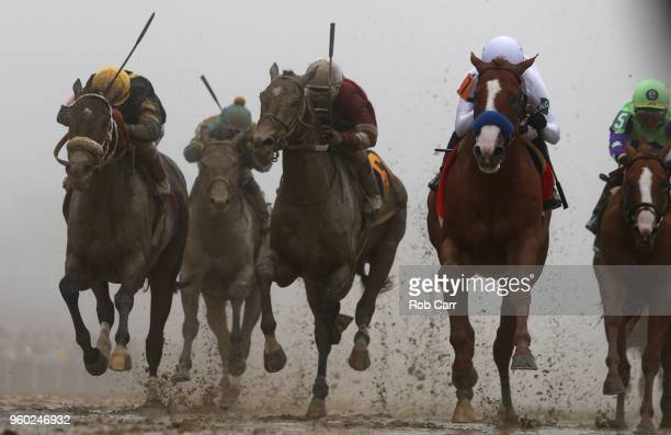 Justify ridden by jockey Mike Smith crosses the finish line to win the 143rd running of the Preakness Stakes at Pimlico Race Course on May 19 2018 in...