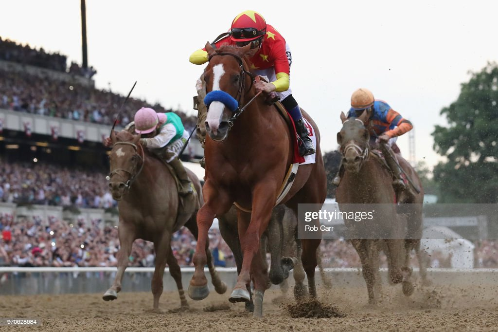 Justify #1, ridden by jockey Mike Smith crosses the finish line to win the 150th running of the Belmont Stakes at Belmont Park on June 9, 2018 in Elmont, New York. Justify becomes the thirteenth Triple Crown winner and the first since American Pharoah in 2015.